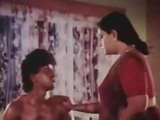 Fat Indian maid seduces her bosses son and blows him