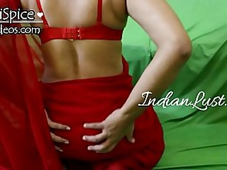 Indian girl in red saree sucking dick